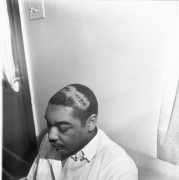 Morris Webb, beaten almost unconscious by officers, just after noon at a restaurant several blocks west of the Clayborn Temple, 1968, Archival Pigment Print