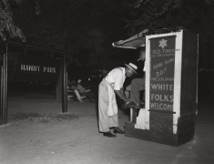 A shoeshine stand in Handy Park, named for composer W. C. Handy, ca. 1960's, Archival Pigment Print