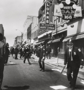 Police converging on marchers with clubs, rifles, and tear gas to stop the looting on Beale and Main Streets, 1968, Archival Pigment Print
