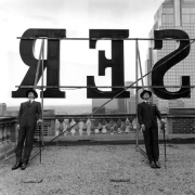 Collin and David Leaning on Rooftop Letters, Alberta, Canada, 2004, Archive Number: HSI-0804-044-02, 16 x 20 Silver Gelatin Photograph