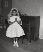 Debra Nell Brittenum in her home late at night in First Communion gown, n.d., Archival Pigment Print