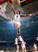 Julius Irving (Dr. J) dunks against Denver Nuggets, Philadelphia, PA, 1977, Color Photograph