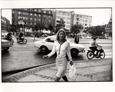 Woman Walking with White Bag, Atlantic Building Behind, 11 x 14 Silver Gelatin Photograph