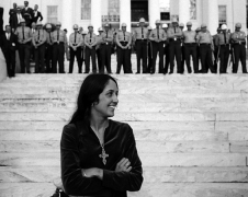 Joan Baez, folk singer, in front of State Troopers, Montgomery Alabama State House. Conclusion of Selma To Montgomery Alabama Civil Rights March, March 25, 1965