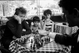 Bob Dylan & Victor Maymudes with Friends Playing Chess Woodstock, NY, 1964, Silver Gelatin Photograph
