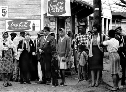 People on street corner watching marchers, Selma to Montgomery, Alabama Civil Rights March; March 23-25, 1965