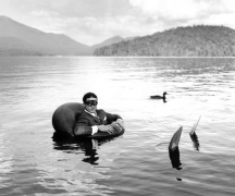 James in Innertube with Duck, Lake Placid, New York, 2006, Archive Number: EBR-0706-029-44, 16 x 20 Silver Gelatin Photograph
