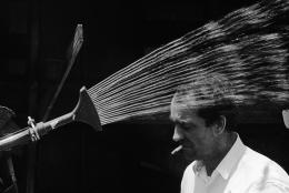 Jean Tinguely with Sprinkler, 1963