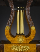 Card Table with Lyre Base, about 1815. Philadelphia. Mahogany, with gilt-brass paw toe caps and castors, strings for the lyres, and gilt-brass and ormolu mounts 28 1/2 in. high, 35 in. wide, 17 1/2 in. deep (at the top), 18 in. deep (at the castors). Detail of open lyre pedestal.