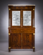 Cabinet with Mirrored Doors, about 1820. Attributed to Duncan Phyfe (1770–1854), New York. Mahogany, with ormolu capitals and bases, gilt-brass door moldings, keyhole liners, and knobs, marble, and mirror plate 78 5/8 in. high, 35 in. wide, 22 in. deep (overall). Frontal view.