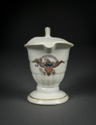 """Helmet-Shaped Creamer with the Seal of the United States and the Motto """"DONT GIVE UP THE SHIP,""""about 1813–15Chinese, for the American MarketPorcelain, partially painted and gilded5 1/4 in. high (to top of handle)"""