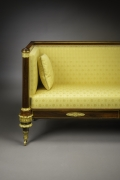 Box Sofa, about 1820. Attributed to Duncan Phyfe (1770–1854), New York. Rosewood and mahogany, partially paint-grained rosewood and gilded, brass line inlay, gilt-brass sabots and castors, and upholstery, 33 3/4 in. high, 82 in. long, 27 1/4 in. deep (detail).