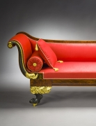 Récamier in the Neo-Classical Taste, about 1820. Attributed to Duncan Phyfe, New York. Mahogany, partially gilded and painted verde antique, with die-stamped gilt-brass mounts, ­bolster buttons, and castors, and die-stamped brass inlaid with ebony. 32 in. high, 82 3/4 in. long, 24 1/2 in. deep