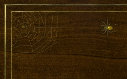 """""""Tiered Table in the Aesthetic Taste,"""" about 1880. A. & H. Lejambre (active 1865–1907), Philadelphia. Mahogany, with inlays of brass, copper, and pewter, and brass moldings, straps and sabots. Closeup of spider and web inlay on tabletop."""
