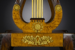Card Table with Lyre Base, about 1815. Philadelphia. Mahogany, with gilt-brass paw toe caps and castors, strings for the lyres, and gilt-brass and ormolu mounts 28 1/2 in. high, 35 in. wide, 17 1/2 in. deep (at the top), 18 in. deep (at the castors). Closeup detail of ormolu mounts on open lyre pedestal and platform.