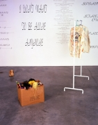 Mike Kelley, Written in the Wind, 1991 (Detail). Cardboard box, 10 found stuffed animals, coat rack with jacket & shirt, ten wall texts, dimensions variable. MP 9180