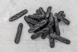 Man, 2017. Burnt baguettes, Dimensions variable.