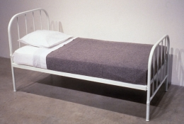 The bed Ethel Rosenberg slept in the night before her execution, 1953-1998. Painted steel bed frame, mattress, pillow, pillowcase, blanket, sheets, 30 1/2 x 54 1/2 x 27 inches. MP 60