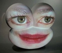 Big Eyes, 2003. Fiberglass Sculpture and DVD Projection, 24 x 24 x 12 inches. MP 362