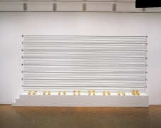 Lineup, 1993. Synthetic polymer on wood, gold-plated shoes, 114 x 216 x 18 inches (289.6 x 548.6 x 45.7 cm).