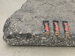Mars (detail), 2018. Two asphalt blocks and 6 Mars bars,