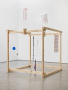 Untitled, 2018. Wood, plastic bag, metal stands, wooden spoon, string, shoelaces, screws, towel, sock, plastic lids, mesh,