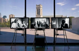 """""""Triangle of Need"""", 2007. Eight channel installation, in collaboration with Sean Griffin, Dylan Skybrook and Kunle Afolayan. Installation view, Walker Art Center, Minneapolis."""