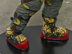 , YINKA SHONIBARE, MBE Refugee Astronaut (detail), 2015 Fibreglass mannequin, Dutch wax printed cotton textile, net, possessions, astronaut helmet, moon boots and steel baseplate 81 7/8 x 36 9/16 x 35 3/8 in. (208 x 93 x 90 cm)