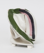 White sculpture, twisted, with strong colored lines