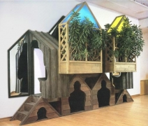 VITO ACCONCI, Houses Up The Wall, 1985, stained wood, vinyl, mirror, plexiglass, light, plants, 10 x 16 x 4 1/2 feet