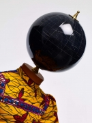 , YINKA SHONIBARE, MBE Butterfly Kid (girl) (detail), 2015 Fiberglass mannequin, Dutch wax printed cotton textile, silk, metal, globe and steel baseplate 49 3/16 x 41 5/16 x 29 7/8 in. (125 x 105 x 76 cm)
