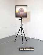 , RICHARD T. WALKER, a paradox in distance, 2014 Lightbox, tripod, Casiotone MT-68 keyboard 78 x 27 x 45 in. (198.1 x 68.6 x 114.3 cm)