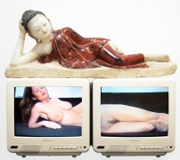, NAM JUNE PAIK Reclining Buddha, 1994 2 color televisions, 2 Pioneer laser disk players, 2 original Paik laser disks, found object 'buddha' 20 x 24 x 14 in. (50.8 x 60.96 x 35.56 cm)