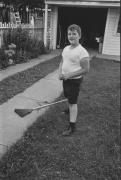 Boy in a backyard, Detroit, 1968