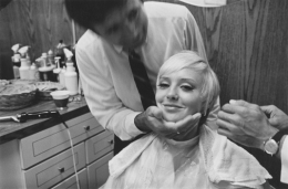 Beauty salon client with a new haircut, Detroit, 1968