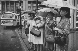 Women waiting at a bus stop in the rain, Detroit, 1968