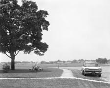 Boy Pointing Rifle at a Car, 1983-84