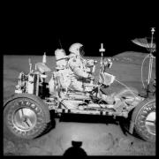 David Scott Drives the First Lunar Rover; Note Aerial Navigation Photographs; Photographed by James Irwin, Apollo 15, July 26-August 7, 1971