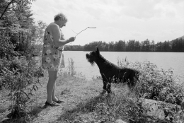 Woman with Giant Schnauzer, Lee's Mill Pond, Moultonbourgh, New Hampshire, 1992