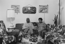 Husband and wife at home with their youngest child, 1968