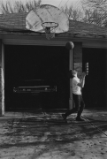 Boy playing basketball, 1968