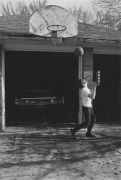 Boy playing basketball, Detroit, 1968
