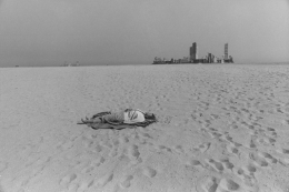 Anthony Hernandez Untitled (Long Beach, Woman on Beach with Buildings in Background), 1970