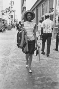 Young woman in a hat on a city street, Detroit, 1968