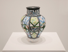 Michael Rakowitz,May The Obdurate Foe Not Be In Good Health:Glazed polychrome ceramic vase, 2017. Middle eastern packaging and newspapers, 13.2 x 10.5 inches.