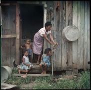 Mother and Children, Mobile, Alabama, 1956.Archival pigment print, 16 x 20 inches, print, 24.125 x 24.125 inches, framed.