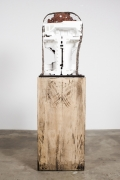 Twins, 2011. Clay, wire, styrofoam, paper, ink acrylic paint, cast iron, metal chain, medallion, 82.5 x 24 x 18 inches.
