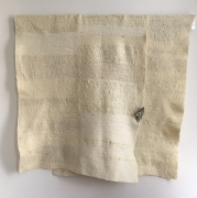 Martha Tuttle,I am reminded of something that once flew, 2018. Wool, white brass, 42 x 39 inches.