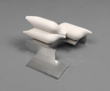 Untitled (11-02), 2011. Cast hydrocal and aluminum, 10.5 x 19 x 18.75 inches.
