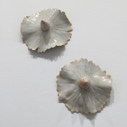 Chris Garofalo. rosie je lekníny, 2007. Glazed porcelain, 5 x 5 x 2 inches, each.